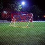 Football Pitch Manhattan, New York, 2001-2004. Silicone color photograph on methacrylate, 32 x 26 cm