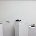 "Adam Basanta. Message Past Future, 2015. Sound installation, 55"" x 55"" x 50"", 3 portable cassette-tape recorders, 3 modified cassette tapes, electronics."